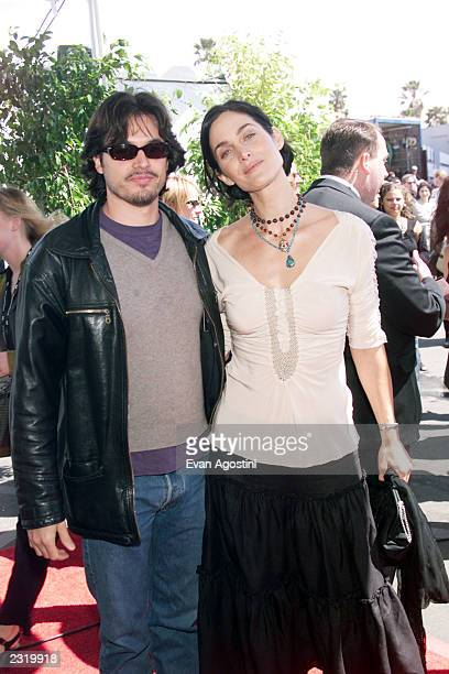 Actress Carrie-Anne Moss with husband Steven Roy arriving on a motorcycle at the 2002 IFP/West Independent Spirit Awards at the beach in Santa...
