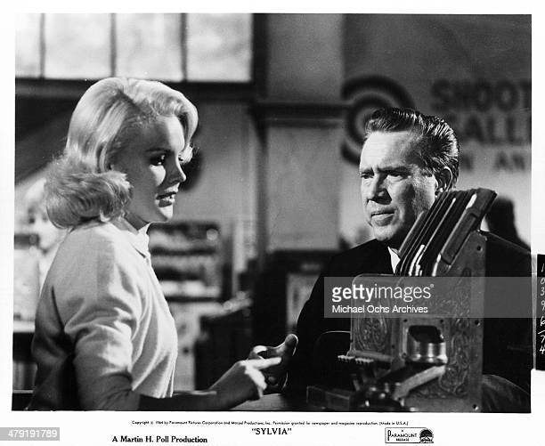 Actress Carroll Baker and actor Edmond O'Brien in a scene from the Paramount Pictures movie 'Sylvia' circa 1965