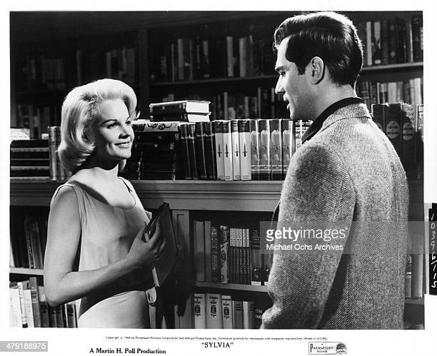 Actress Carroll Baker and actor George Maharis in a scene from the Paramount Pictures movie Sylvia circa 1965