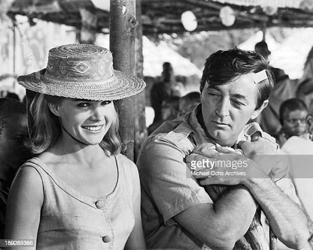 Actress Carroll Baker and actor Robert Mitchum on the set of the movie ' Mister Moses' in 1965