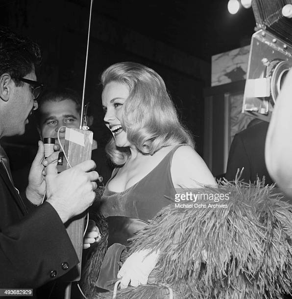 Actress Carroll Baker is interviewed during the premier of 'How the West Was Won' in Los Angeles California