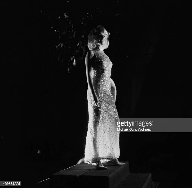 Actress Carroll Baker poses in a sheer gown in Los Angeles California