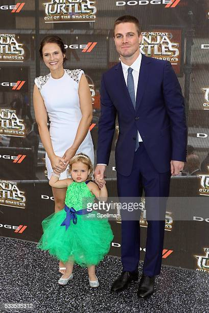 """Actress Cassandra Jean , actor Stephen Amell and daughter Mavi Alexandra Jean Amell attend the """"Teenage Mutant Ninja Turtles: Out Of The Shadows""""..."""