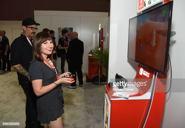Actress Cassandra Morris plays Super Mario Odyssey at the Nintendo booth at the 2017 E3 Gaming Convention at Los Angeles Convention Center on June 15...