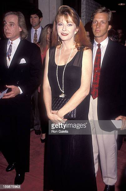 Actress Cassandra Peterson and actor Martin Rabbett attend the Rambling Rose Westwood Premiere on September 19 1991 at the Mann National Theatre in...