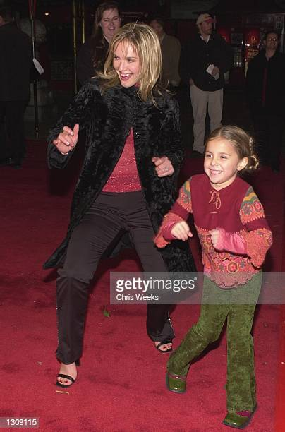 Actress Cassidy Rae and daughter Mackenzie Vega arrive at the Universal Pictures and Beacon Pictures premiere of The Family Man December 12 2000 at...