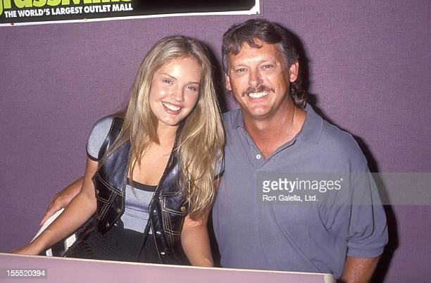 Actress Cassidy Rae and father Joe Joyce attend the InStore Appearance by Cast of Models Inc on August 13 1994 at Sawgrass Mills Mall in Fort...