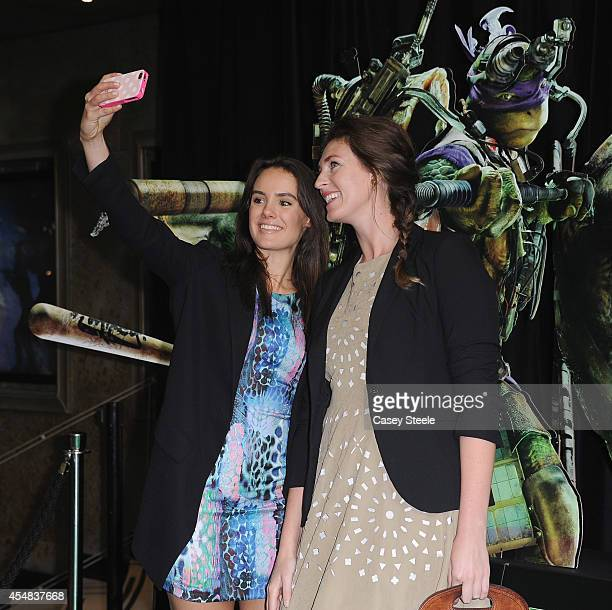 Actress Cassie Howarth takes a selfie with friend at the Sydney Premiere of Teenage Mutant Ninja Turtles at The Entertainment Quarter on September 7...