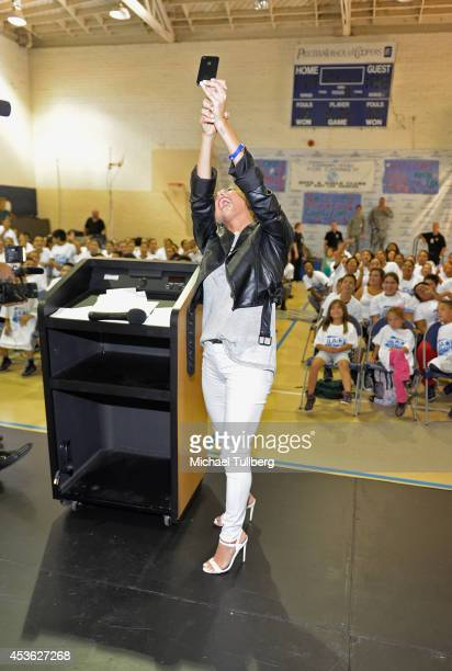 Actress Cassie Scerbo takes a selfie with the audience at the Be A STAR Antibullying Rally For 200 Students at Boys Girls Club Of East Los Angeles on...