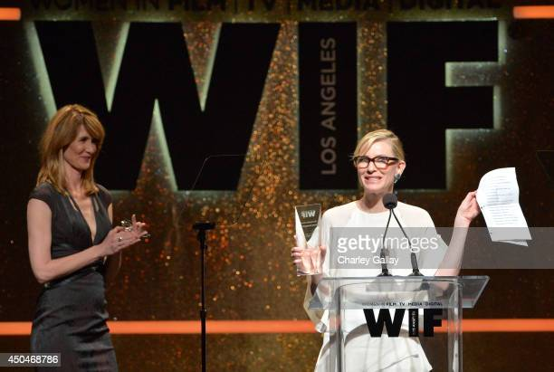 Actress Cate Blanchett accepts the Crystal Award for Excellence in Film onstage as actress Laura Dern looks on at Women In Film 2014 Crystal Lucy...
