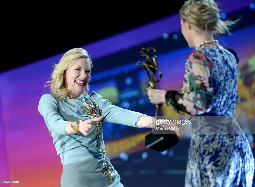 Actress Cate Blanchett (L) accepts the Desert Palm Achievement Award from actress Saoirse Ronan onstage at the 27th Annual Palm Springs International Film Festival Awards Gala at Palm Springs Convention Center on January 2, 2016 in Palm Springs, California.
