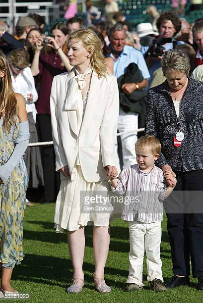 Actress Cate Blanchett and son Dashiell watch during Cartier International Day at Guards Polo Club Windsor Great Park on July 24 2005 in Windsor...