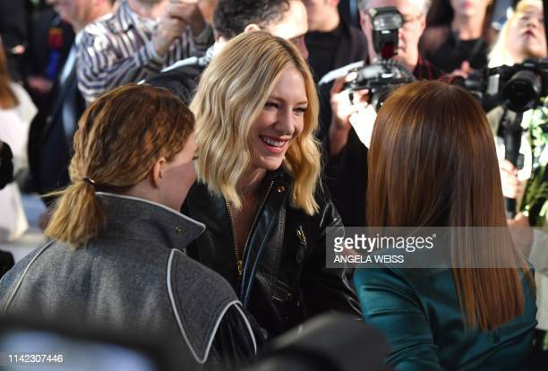 Actress Cate Blanchett greets Lea Seydoux and Emma Stone during the Louis Vuitton Cruise 2020 Fashion Show at TWA Flight Center at JFK Airport on May...