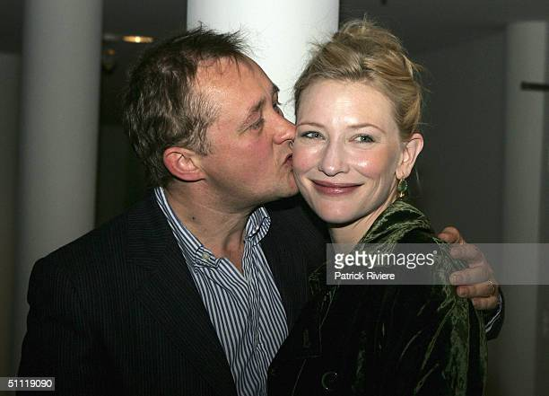 Actress Cate Blanchett is kissed by her director husband Andrew Upton as they arrive during the opening night party for Hedda Gabler at the Sydney...