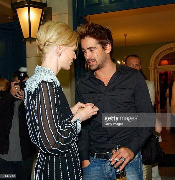 """Actress Cate Blanchett talks with actor Colin Farrell at the after party of the world premiere of """"Veronica Guerin"""" in Dublin Castle on July 8, 2003..."""