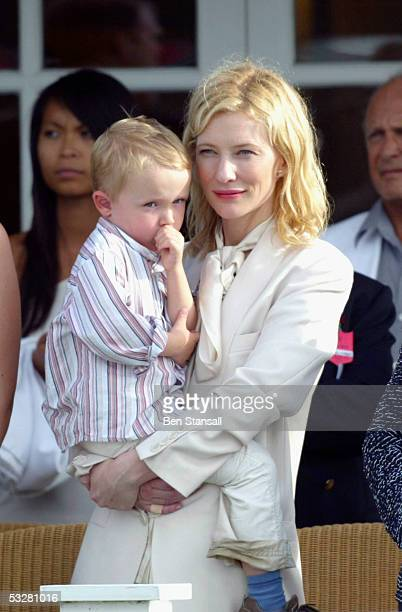 Actress Cate Blanchett watches with her son Dashiell on Cartier International Day at Guards Polo Club Windsor Great Park on July 24 2005 in Windsor...