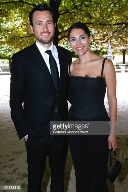 Actress Caterina Murino and companion Australian Doctor David Jones the 'Qeelin' high Jewellery Exhibition opening Cocktail 'Mogoaku in Paris' at...