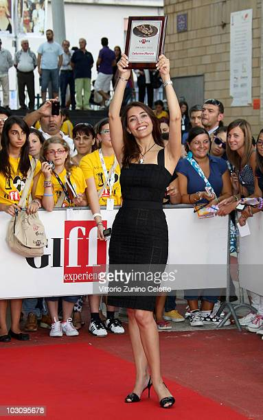 Actress Caterina Murino poses with the Giffoni Award during Giffoni Experience 2010 on July 26 2010 in Giffoni Valle Piana Italy