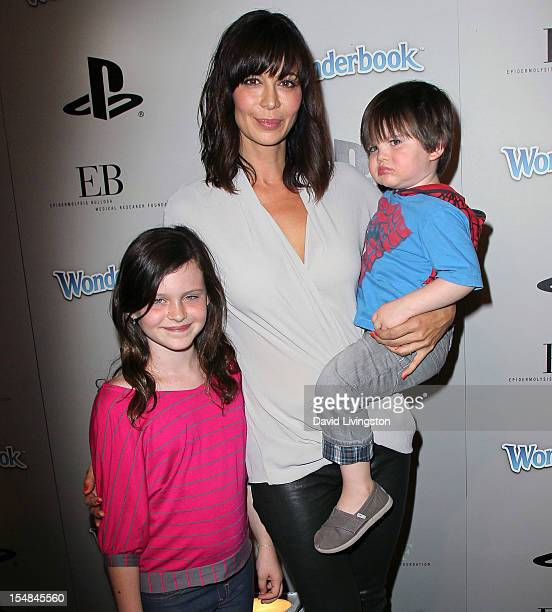 Actress Catherine Bell and children Gemma and Ronan attend EBMRF Sony PlayStation's Epic Halloween Bash hosted by James Marsden and Courteney Cox on...