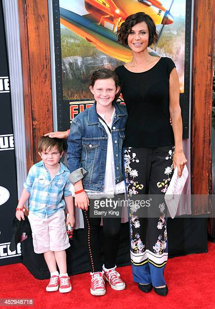 Actress Catherine Bell and children Ronan Beason and Gemma Beason attend the premiere of 'Planes Fire Rescue' on July 15 2014 at the El Capitan...