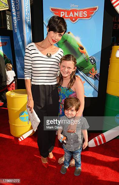 Actress Catherine Bell and daughter Gemma Beason and son Ronan Beason attend the premiere of Disney's Planes at the El Capitan Theatre on August 5...