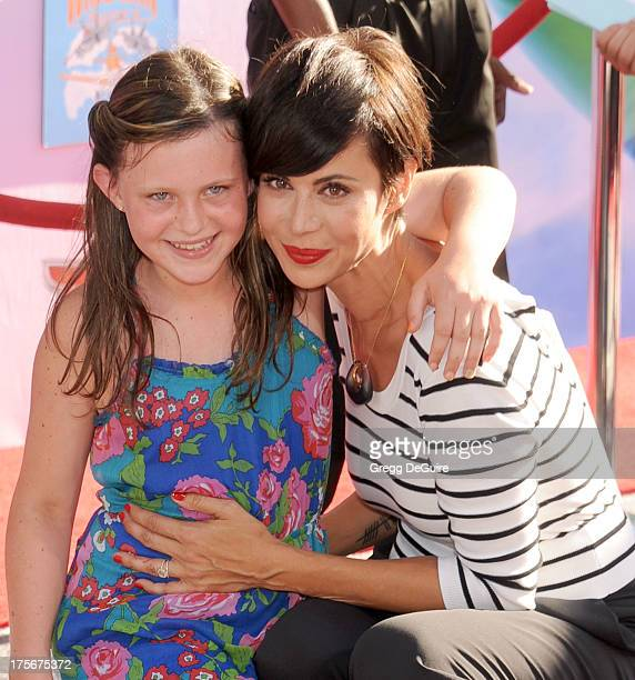 Actress Catherine Bell and daughter Gemma Beason arrive at the Los Angeles premiere of Planes at the El Capitan Theatre on August 5 2013 in Hollywood...