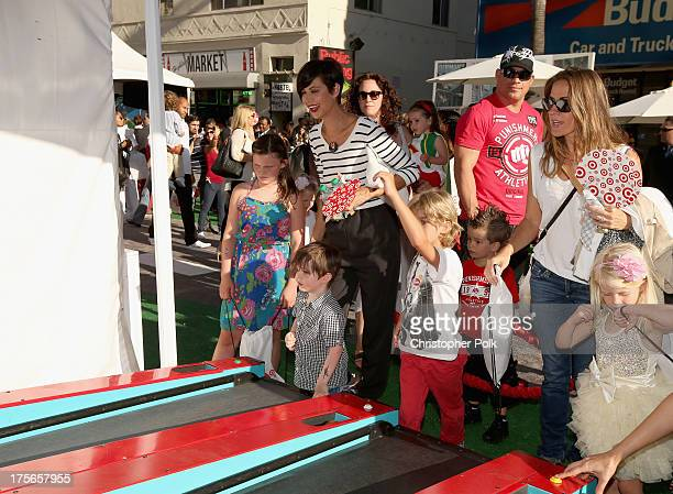 "Actress Catherine Bell and family explore the Target Landing Zone at the World Premiere of ""Disney's Planes"" at the El Capitan Theatre on Aug 5 in..."