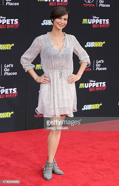 """Actress Catherine Bell arrives at the Los Angeles premiere of """"Muppets Most Wanted"""" at the El Capitan Theatre on March 11, 2014 in Hollywood,..."""