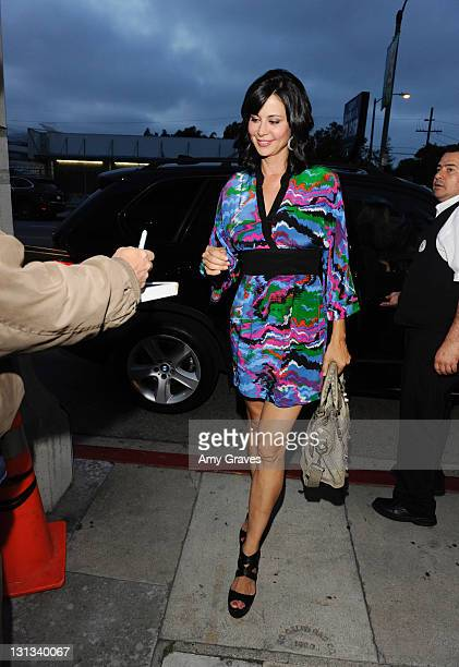 Actress Catherine Bell attend the Artists Against Drugs Art show at Satine Boutique on May 21 2011 in Los Angeles California