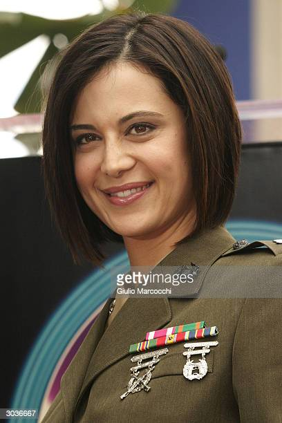 Actress Catherine Bell attends a Star On The Walk Of Fame ceremony for Donald P Bellisario March 2 2004 in Hollywood California