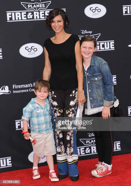 Actress Catherine Bell daughter Gemma and son Ronan attend the premiere of 'Planes Fire Rescue' at the El Capitan Theatre on July 15 2014 in...