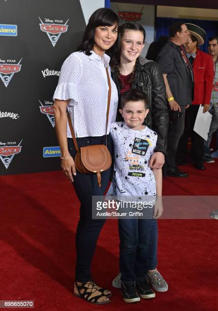 Actress Catherine Bell daughter Gemma Beason and son Ronan Beason arrive at the premiere of 'Cars 3' at Anaheim Convention Center on June 10 2017 in...