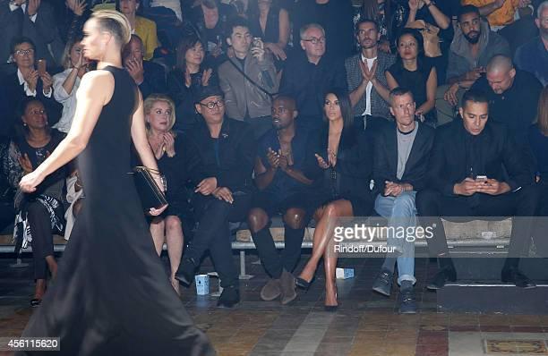 Actress Catherine Deneuve, Alex Koo, Kanye West, Kim Kardashian and Lanvin men fashion designer Lucas Ossendrijver attend the Lanvin show as part of...