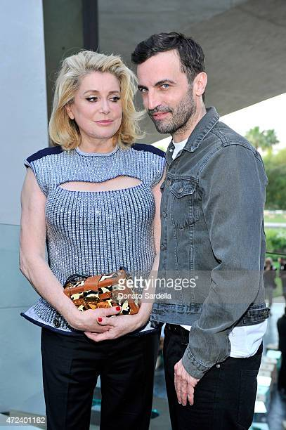 Actress Catherine Deneuve and designer Nicolas Ghesquiere backstage at the Louis Vuitton Cruise 2016 Resort Collection shown at a private residence...