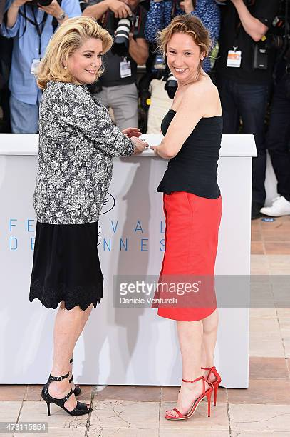 Actress Catherine Deneuve and director Emmanuelle Bercot attend the La Tete Haute photocall during the 68th annual Cannes Film Festival on May 13...