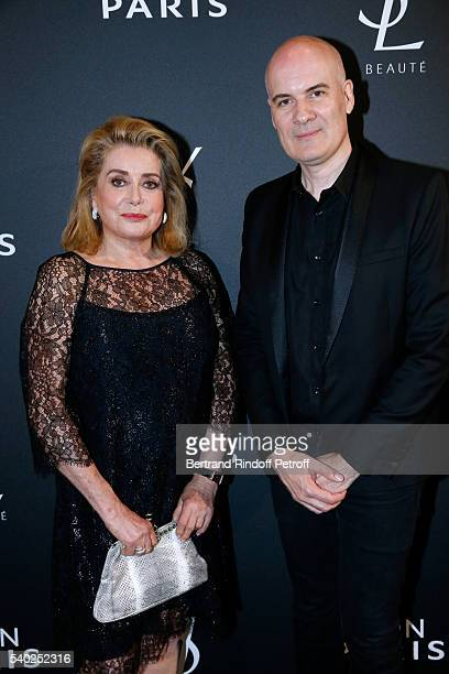 Actress Catherine Deneuve and General Director of of Yves Saint Laurent Stephan Bezy attend YSL Beauty launches the new Fragrance 'Mon Paris' at Cafe...