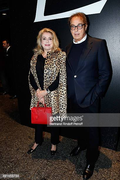 Actress Catherine Deneuve and Gilles Dufour attend the Saint Laurent show as part of the Paris Fashion Week Womenswear Spring/Summer 2016 on October...