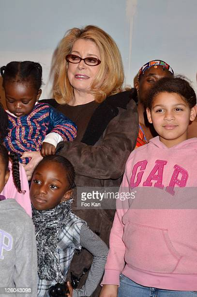 Actress Catherine Deneuve and kids attend the 'Charity Event For Children in Haiti' hosted by the CIRA at the Hotel Bristol on January 5 2011 in...