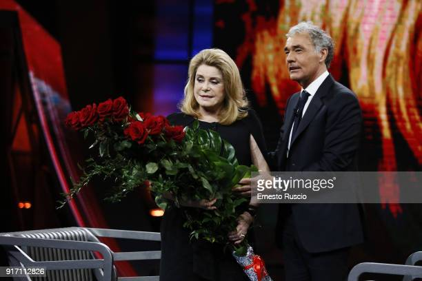 Actress Catherine Deneuve and Massimo Giletti attend the Non E' L'Arena at Ex De Paolis Studios on February 11 2018 in Rome Italy