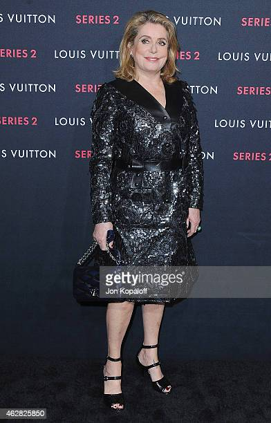 "Actress Catherine Deneuve arrives at Louis Vuitton ""Series 2"" The Exhibition on February 5, 2015 in Hollywood, California."