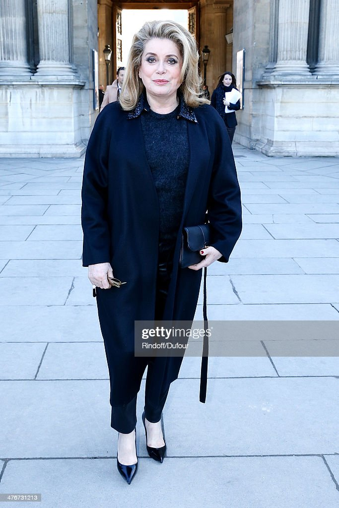 Actress Catherine Deneuve attends the Louis Vuitton show as part of the Paris Fashion Week Womenswear Fall/Winter 2014-2015 on March 5, 2014 in Paris, France.