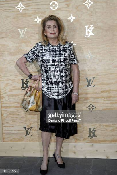 Actress Catherine Deneuve attends the LVxKOONS exhibition at Musee du Louvre on April 11 2017 in Paris France