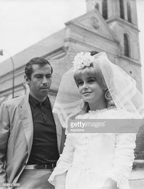 Actress Catherine Deneuve dressed as a bride with director Roger Vadim on the set of the film 'The Vice and the Virtue' July 31st 1962