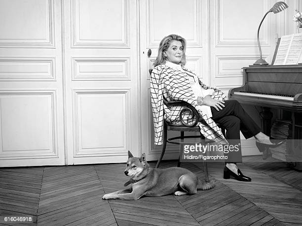 Actress Catherine Deneuve is photographed for Madame Figaro on August 30, 2016 in Paris, France. Coat , pants , shirt , bracelet , shoes . PUBLISHED...