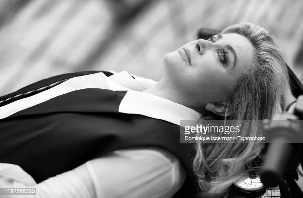 Actress Catherine Deneuve is photographed for Madame Figaro on March 14, 2019 in Paris, France. Vest and shirt by Louis Vuitton. Make-up by...