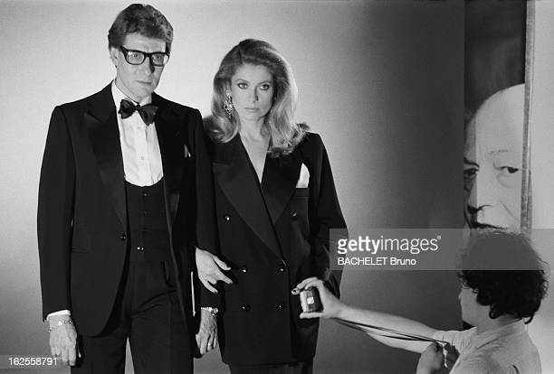 Actress Catherine Deneuve poses with fashion designer Yves Saint Laurent in a photo-shoot by German photographer Helmut Newton, 16th November 1981....