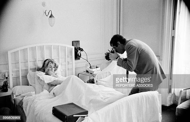 Actress Catherine Deneuve with Her Newborn Child Christian Vadim and his Father Director Roger Vadim at the Clinic, in Paris, France, in June 1963 .