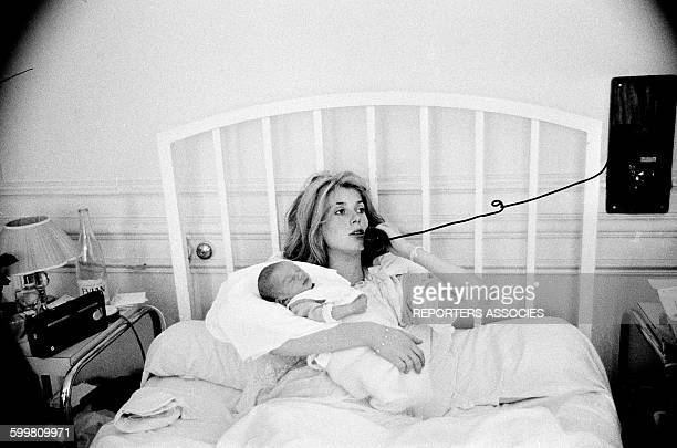 Actress Catherine Deneuve with Her Newborn Child Christian Vadim at the Clinic in Paris, France, in June 1963 .