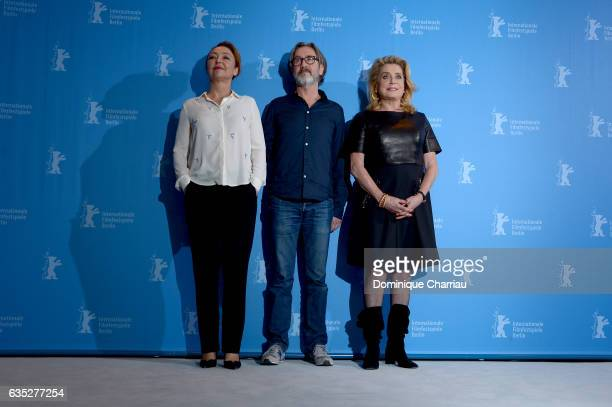 Actress Catherine Frot director Martin Provost and actress Catherine Deneuve attend the 'The Midwife' photo call during the 67th Berlinale...