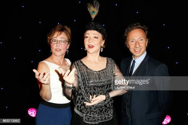 Actress Catherine Frot poses with her wax statue with Stephane Bern during Catherine Frot waxwork unveiling at Musee Grevin on April 30 2018 in Paris...